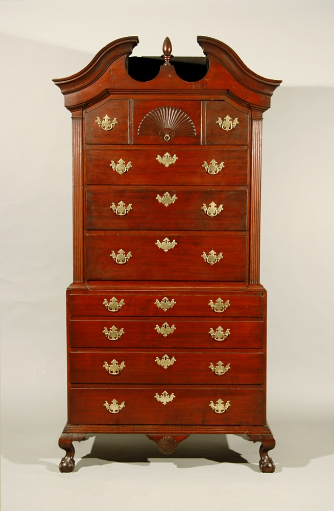 A fine and rare New Hampshire 'bonnet-topped' chest on chest