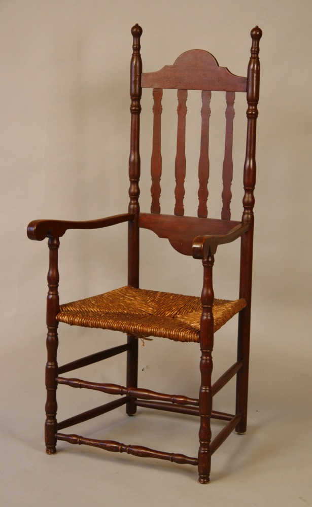 A fine and rare bannister-backed armchair