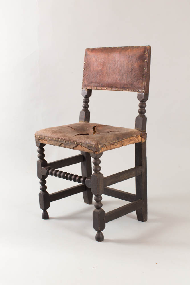 >An exceptionally rare 17th century turned 'leather' chair
