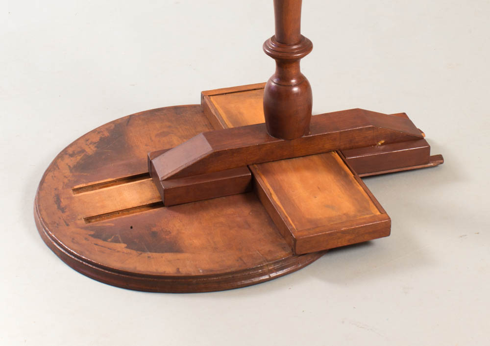 A rare Chapin School dished top candlestand with molded edge