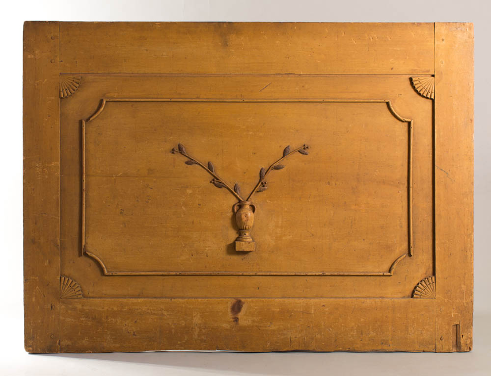 >A rare fireboard with applied urn and floral decoration