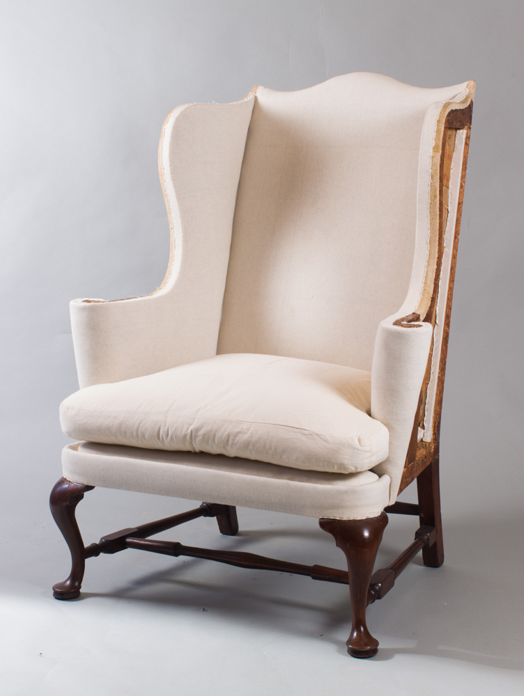 a very fine queen anne wing chair with scrolled crest and wings