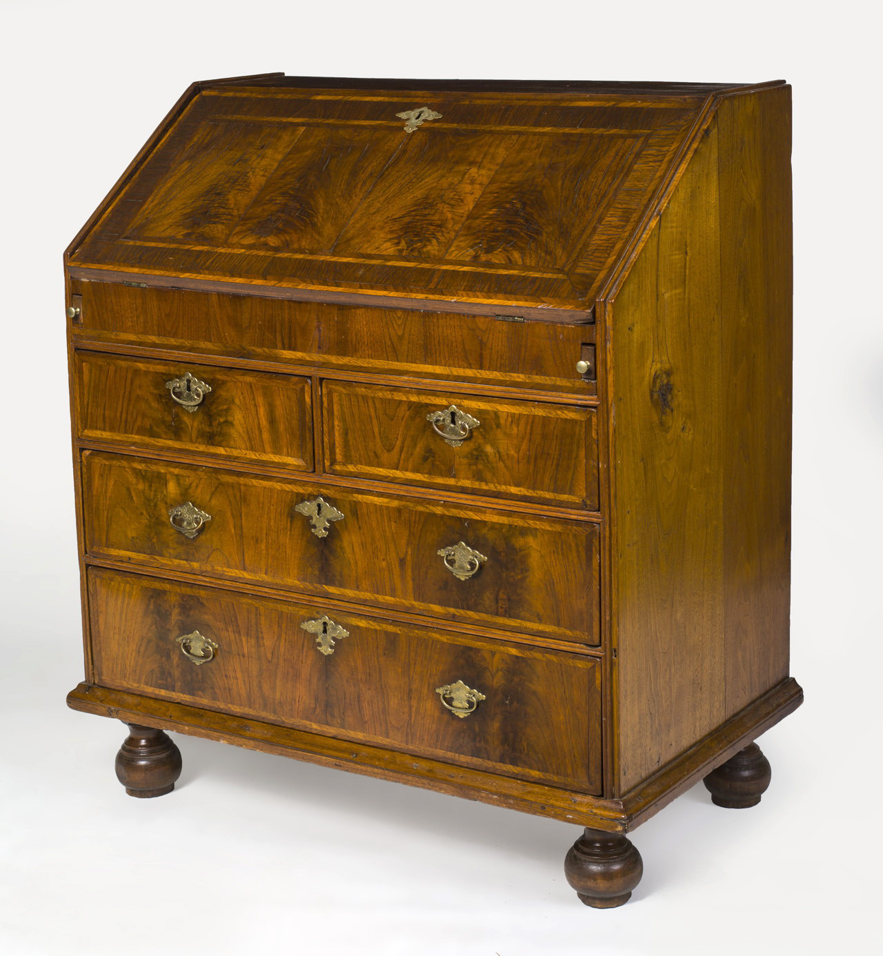 A very rare Boston area (c.1715-20) walnut and walnut-veneered desk